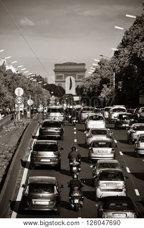 PARIS, FRANCE - MAY 13: Busy traffic on highway on May 13, 2015 in Paris. With the population of 2M, Paris is the capital and most-populous city of France