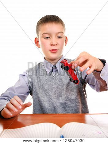 Kid play with a Toy on the School Desk on the white background