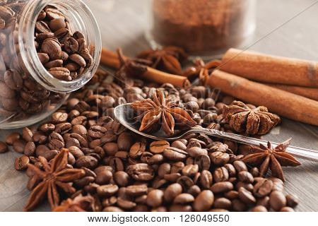 Composition with coffee and aromatic ingredients closeup selective focus