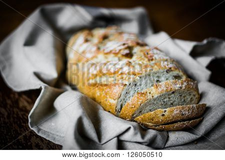 Image of Whole Grain Bread On Rustic Background