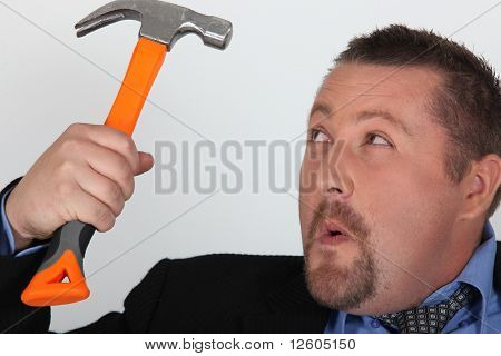 Portrait of a businessman with a hammer