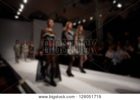 Fashion runway out of focus. The blur background