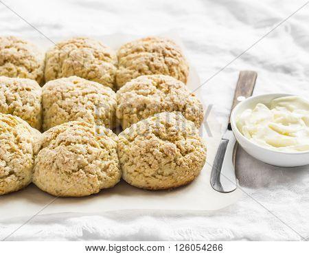 Orange oatmeal scones on a light background
