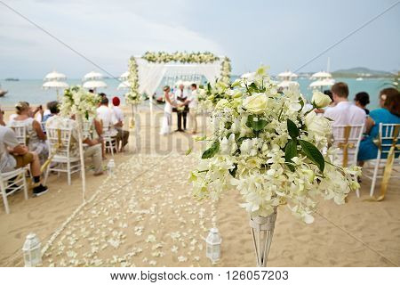 soft focus of beautiful flower decoration in the beach wedding ceremony