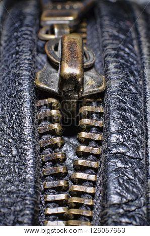Macro metal zipper on black leather jacket