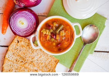 Photos of Minestrone Soup On Wooden Background