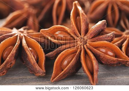 Star anise with seeds on a wooden table closeup macro shot selective focus