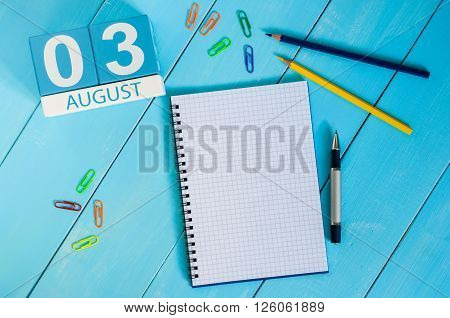 August 3rd. Image of august 3 wooden color calendar on blue background. Summer day. Empty space for text.