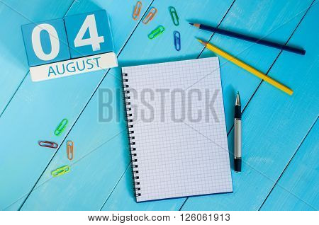 August 4th. Image of august 4 wooden color calendar on blue background. Summer day. Empty space for text.