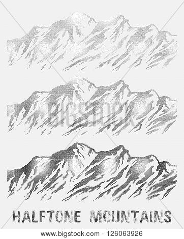 Halftone nountain range set. Black and white huge dotted isolated mountains. Vector illustration.