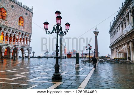 VENICE - NOVEMBER 20: San Marco square with tourists on November 20 2015 in Venice Italy. It's the principal public square of Venice Italy where it is generally known just as the Piazza.