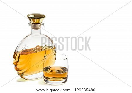 Bottle of whiskey and a glass on a white background