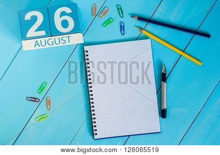 August 26th. Image of august 26 wooden color calendar on blue background. Summer day. Empty space for text.