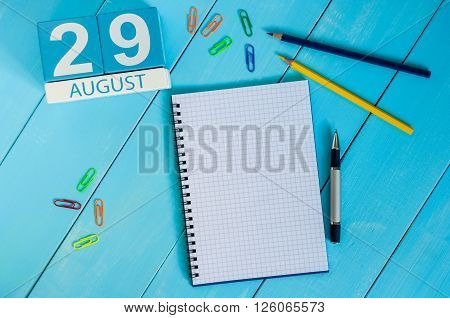 August 29th. Image of august 29 wooden color calendar on blue background. Summer day. Empty space for text.