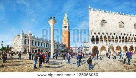 VENICE - NOVEMBER 22: San Marco square with tourists on November 22 2015 in Venice Italy. It's the principal public square of Venice Italy where it is generally known just as the Piazza.