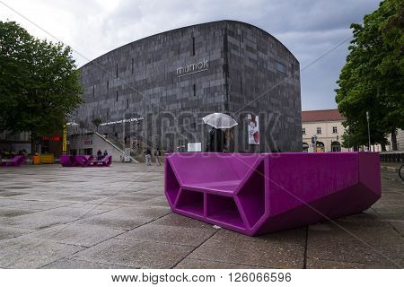 Vienna, Austria - May 6: People Rest On Red Benches In Front Of The Mumok, Museum Of Modern Art  At