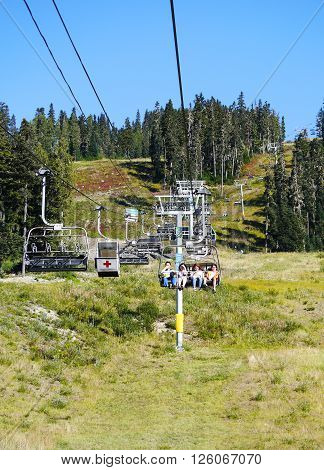 WHISTLER, BC, CANADA : August 18 2015.  Visitors riding the Wizard Chair on Blackcomb Mountain. Whistler, BC, Canada August 18 2015