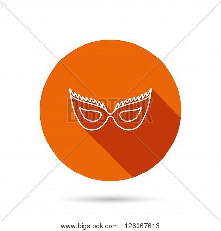 Festive mask icon. Masquerade carnival sign. Anonymous symbol. Round orange web button with shadow.