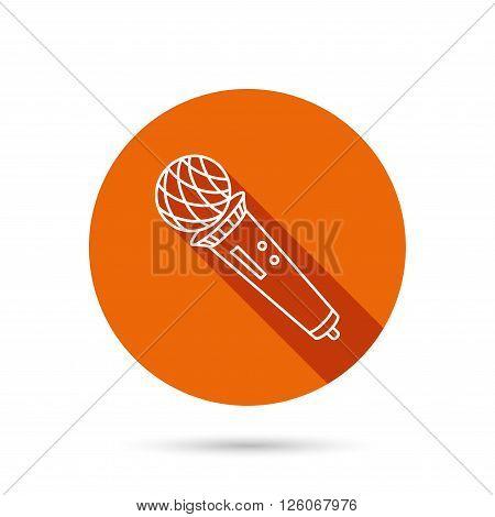 Microphone icon. Karaoke or radio sign. Round orange web button with shadow.