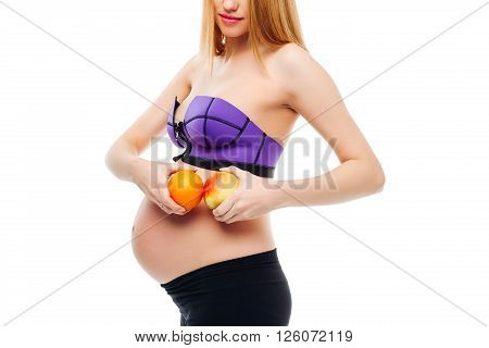 Heathy food for my baby. Pregnant woman holding fruits, studio isolated