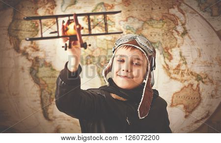 child boy teenager dreams of becoming a pilot and an aviator traveling