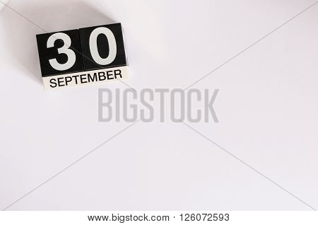 September 30th. Image of september 30 wooden table calendar on white background. Autumn day. Empty space for text. International Translation Day.