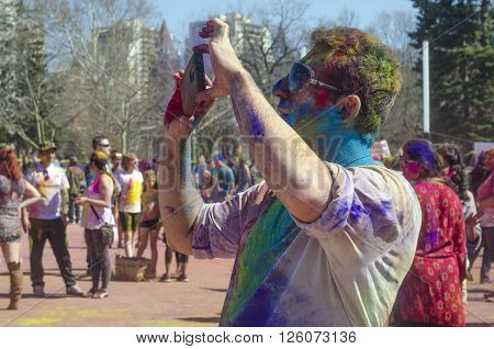 London Ontario, Canada - April 16:  Unidentified Young Colorful Boy Taking Photos With The Phone And