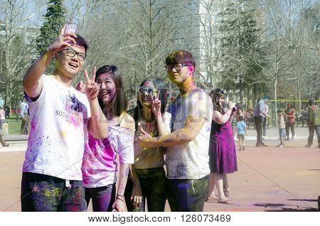 London Ontario, Canada - April 16:  Unidentified Young Colorful Guys Taking Photos With The Phone An