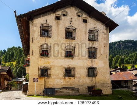 Colle Santa Lucia, Italy - September 6, 2012: Old house Casa 'Chizzali-Bonfadini' in the small town of Colle Santa Lucia along the Great Dolomite Road in Italian Alps