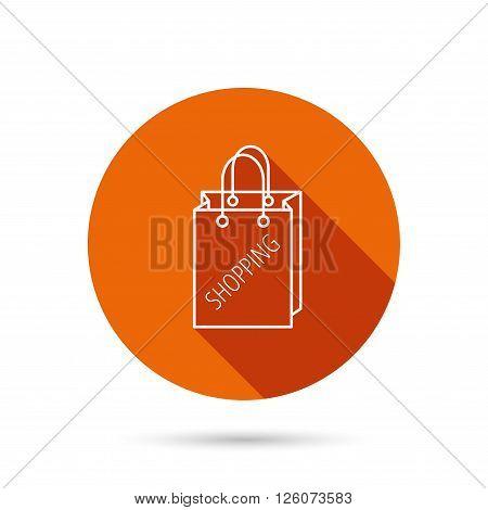 Shopping bag icon. Sale handbag sign. Round orange web button with shadow.
