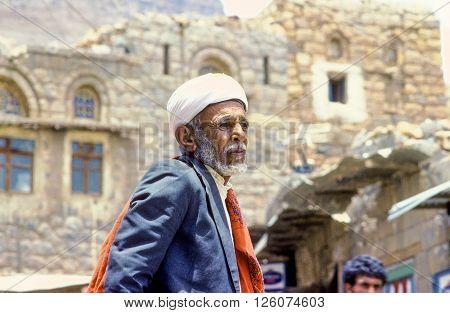 SANAA YEMEN - JUNE 30 1991: portrait of old senior man with the typical yemenite dress The turban and the neck scarf in Sanaa Yemen