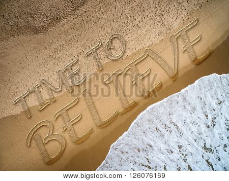 Time to Believe written on the beach