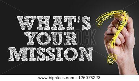 Hand writing the text: Whats Your Mission?