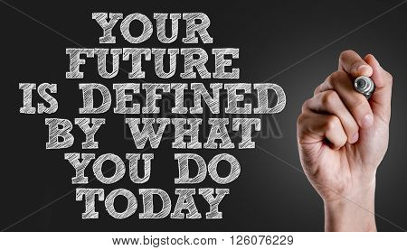 Hand writing the text: Your Future is Defined By What You Do Today