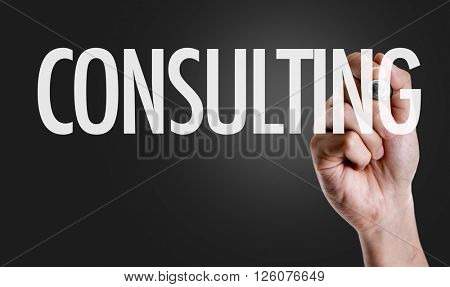 Hand writing the text: Consulting