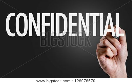 Hand writing the text: Confidential