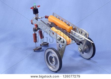 homemade puppet man of the electronic components with a cart and tools