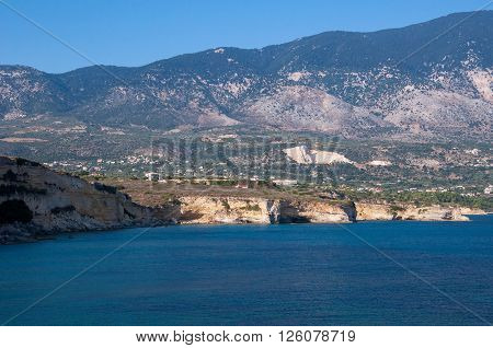 Cliff coast of Kefalonia island in afternoon sun Greece ** Note: Visible grain at 100%, best at smaller sizes
