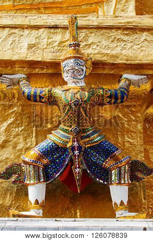 Sculpture in Royal Palace Bangkok Thailand. Wat Phra Keo. Architecture detail - statue of mythical creature with green skin.