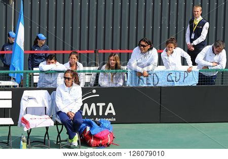 KYIV UKRAINE - APRIL 16 2016: Captain of Argentina National Team Maria-Jose Gaidano (on a foreground) and Argentinian players look on during BNP Paribas FedCup game Ukraine vs Argentina