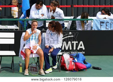 KYIV UKRAINE - APRIL 16 2016: Captain of Argentina National Team Maria-Jose Gaidano (R) and player Nadia Podoroska look on during BNP Paribas FedCup game Ukraine vs Argentina at Campa Tennis Club