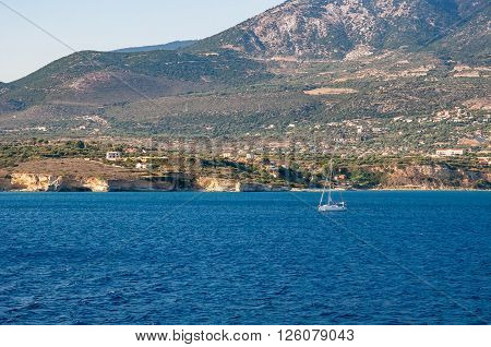 Sailboat on blue sea atcoast of Kefalonia island Greece