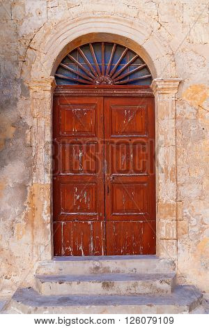 Old wooden door with stained glass . Mdina Malta.