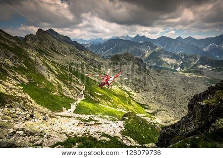 Zako pane, Poland-July 4, 2015:Helicopter mountain rescue service in the High Tatras.