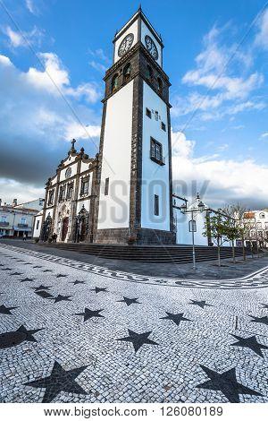 Ponta Delgada Azores Portugal - April 20 2015: Tower of St. Sebastian church (Igreja Matriz de Sao Sebastiao) in Ponta Delgada San Miguel the Autonomous Region of the Azores Portugal.