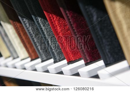 Fabric samples in row, upholstery and carpet textile examples for car interior