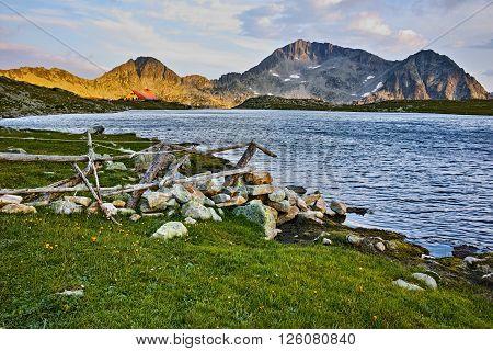 Last Ray of sun over Tevno Lake and Kamenitsa peak, Pirin mountain, Bulgaria