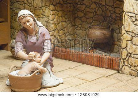 Badajoz Spain - January 4 2013: Mary bathes Baby Jesus. Diorama built by Local Association of Friends of Cribs Badajoz 2013
