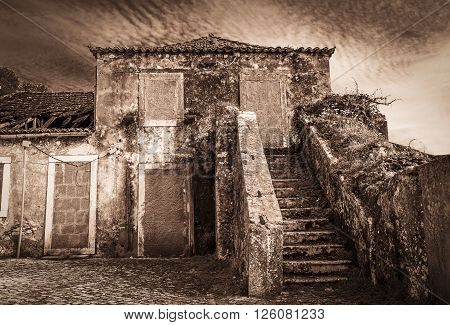 a dramatic ancient house closed with cement