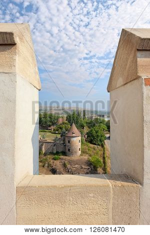 HUNEDOARA, ROMANIA - AUGUST 13, 2015: battlements and medieval round tower of Corvin Castle in Hunedoara, Romania